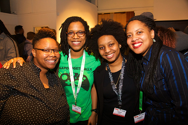 Four gaming industry professionals from the black community pose for a photo at the Green Room event