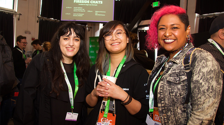 Three gaming industry professionals from the LGBTQIA community pose for a photo at GDC