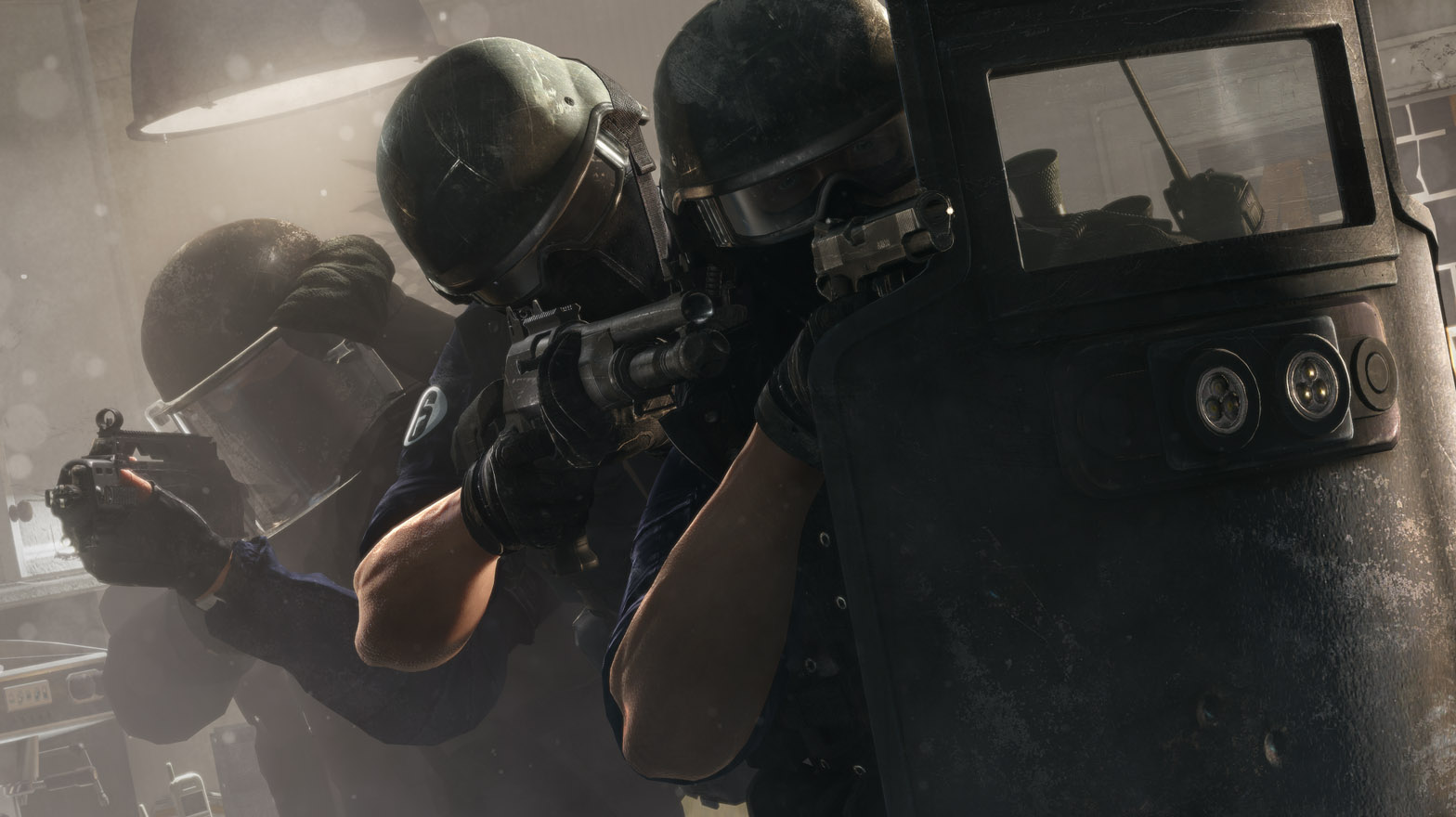 Two men in armor behind a riot shield from the game Rainbox Six Seige